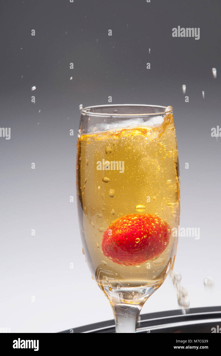 Close-up of a strawberry in a champagne flute - Stock Image