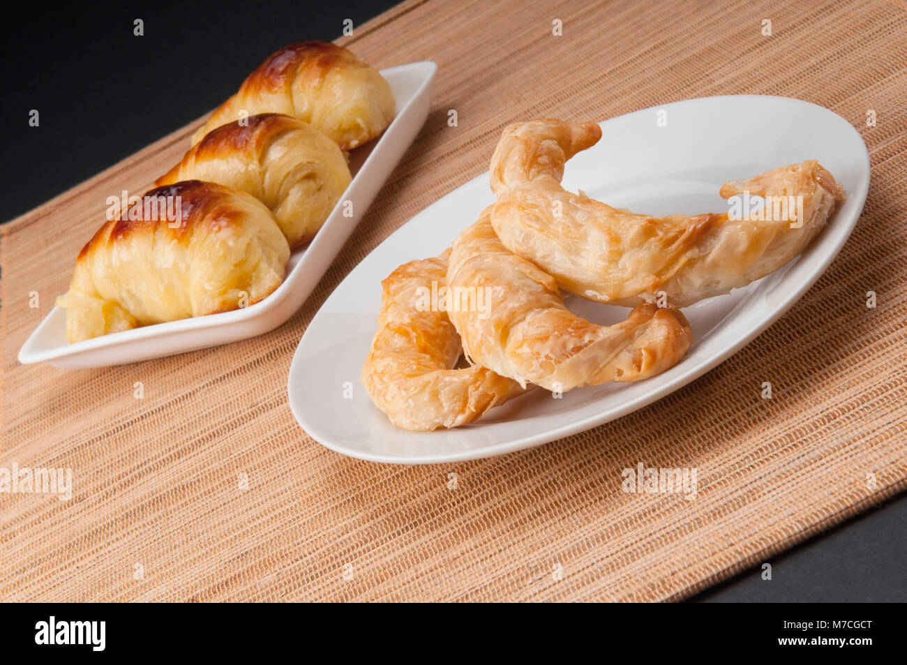 Close-up of croissants on platters - Stock Image