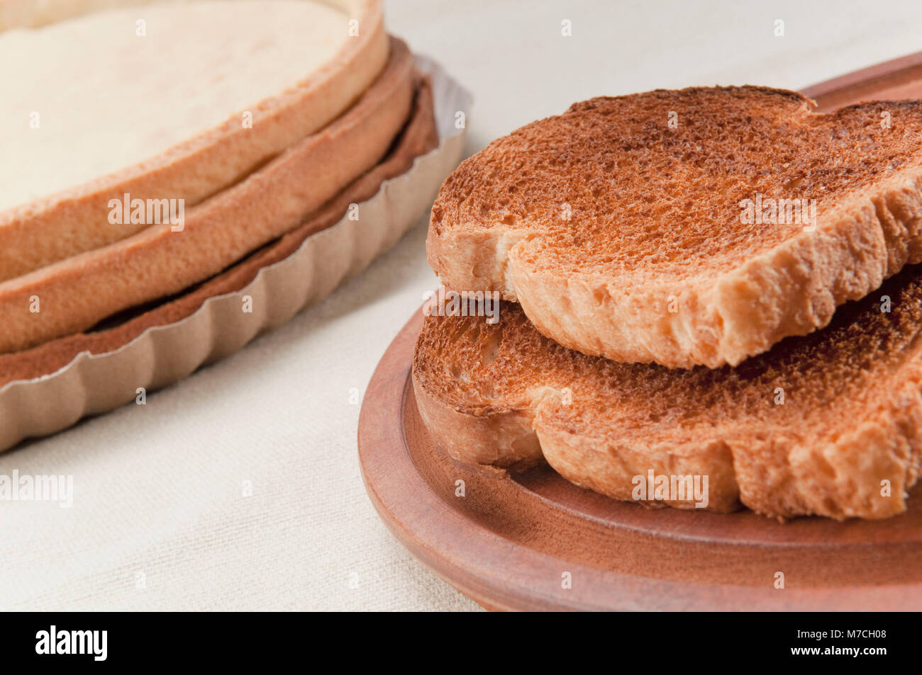 Close-up of breads with tart bases - Stock Image