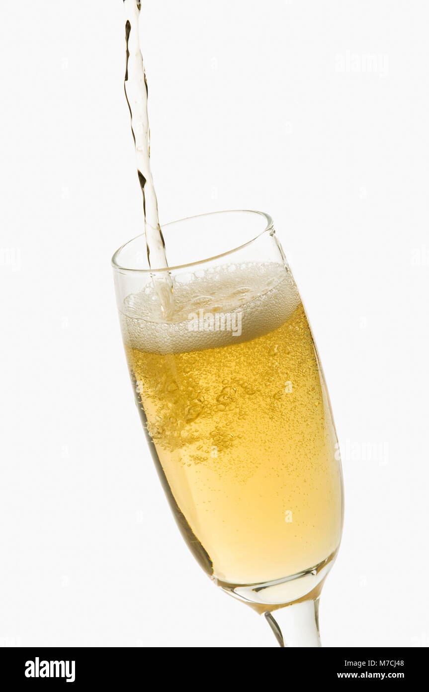 Close-up of champagne being poured into a champagne flute - Stock Image