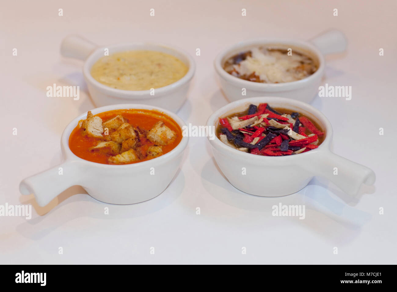 High angle view of four assorted soups - Stock Image