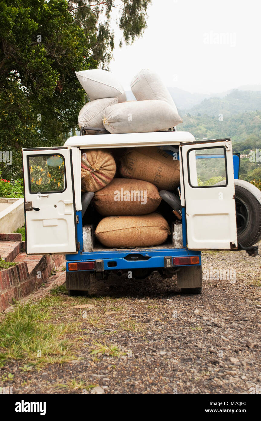 Sacks of coffee beans in a jeep, Colombia Stock Photo