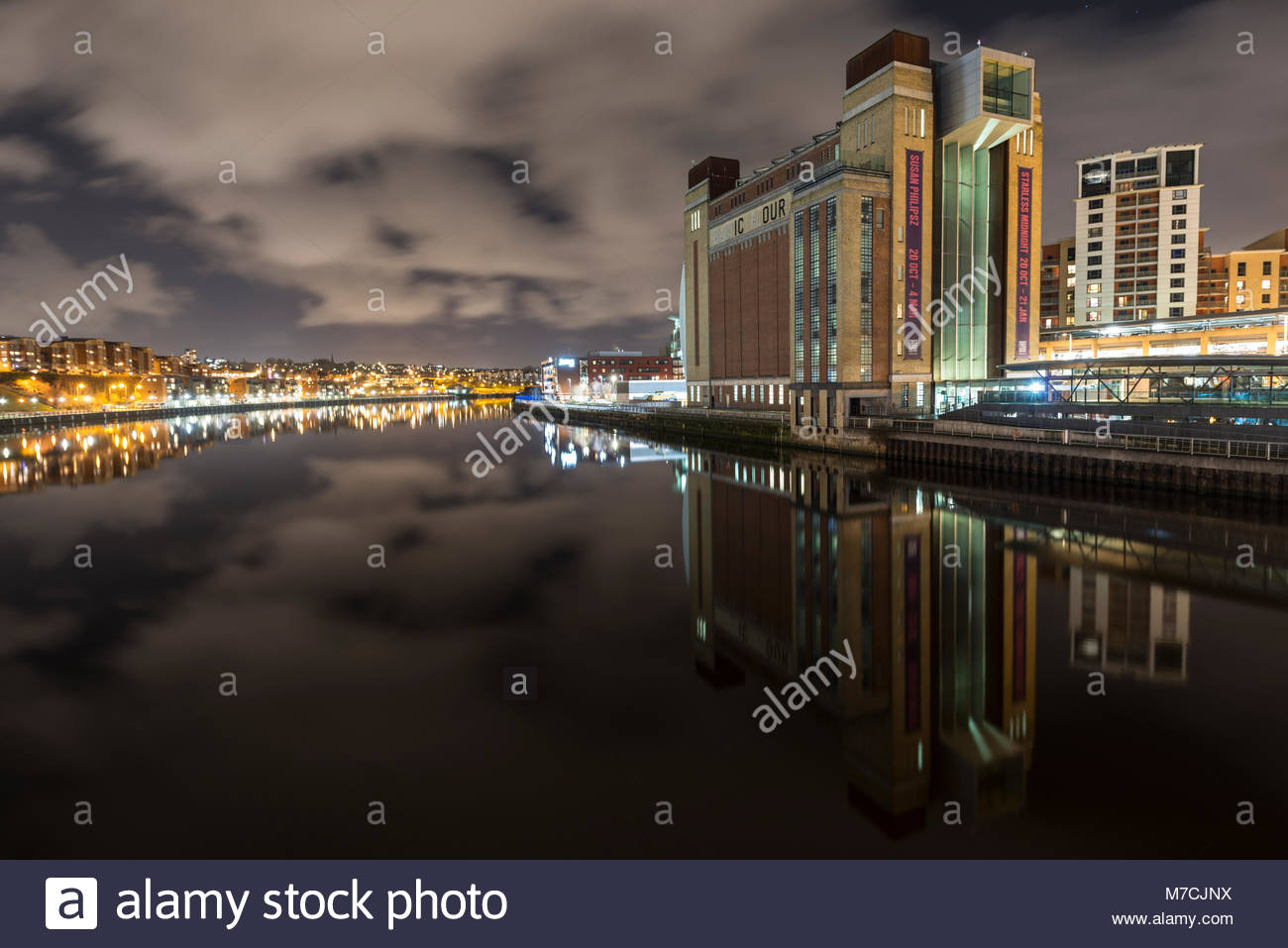 The Baltic Arts Centre, newcastle quayside and cloudy sky reflecting in The River tyne at night Stock Photo
