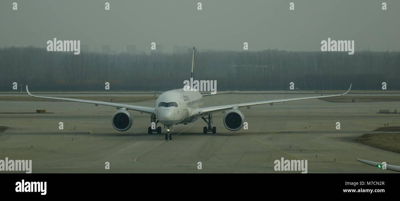 Beijing, China - Feb 17, 2018. A civil aircraft on runway at Beijing Capital Airport (PEK), China. The airport is - Stock Image