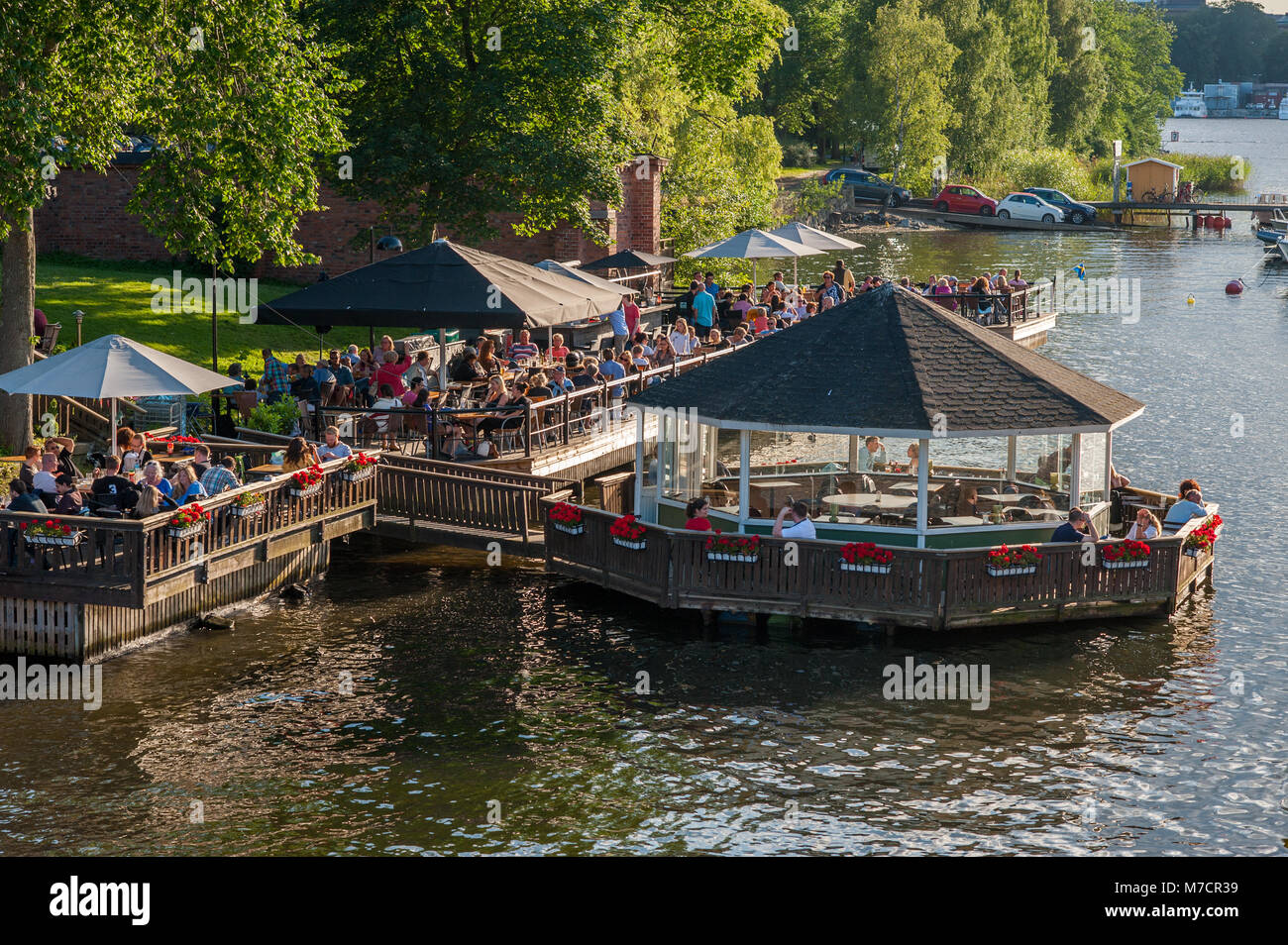 View towards a waterfront café at Djurgården during summer in Stockholm. Djurgården is a famous recreational area Stock Photo
