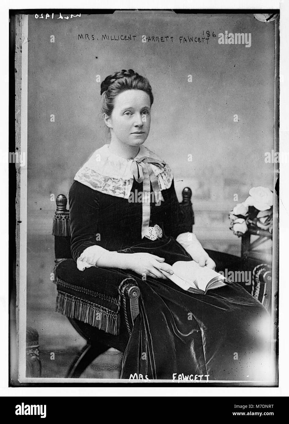 Mrs. Millicent Garrett Fawcett, seated with book LCCN2014681079 - Stock Image