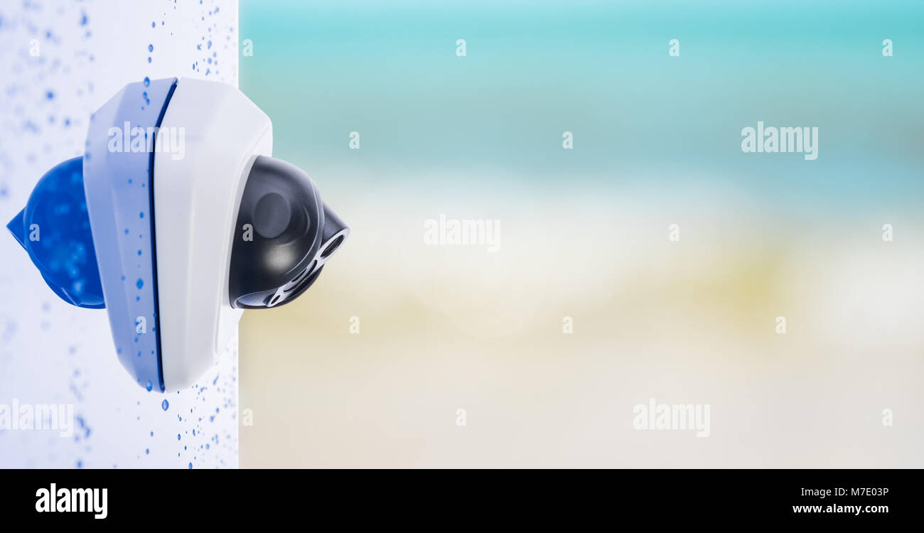 IP Camera on the wet wall, beautiful blurry background with copyspace. Concept - technology and security - Stock Image