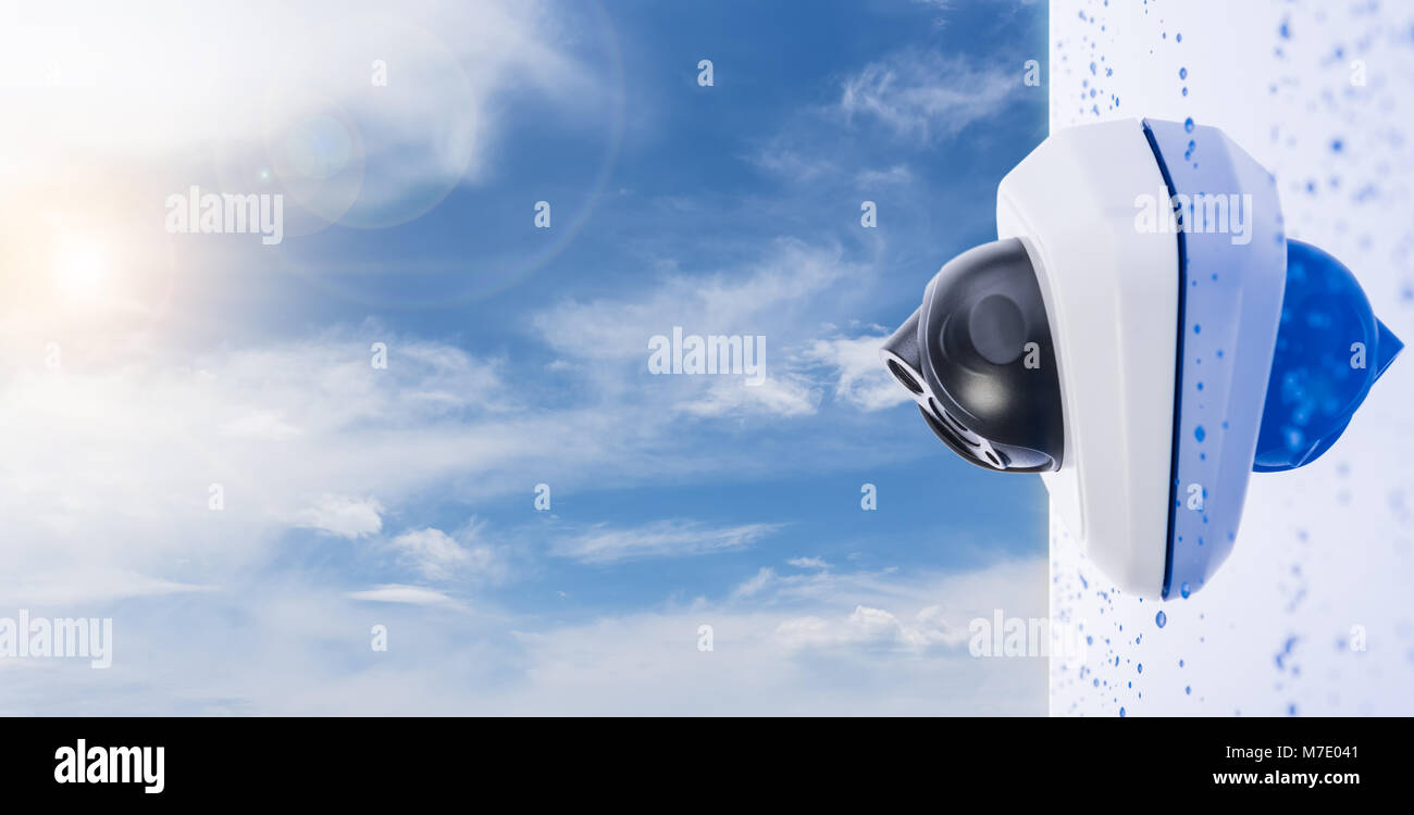 IP Camera on the wet wall, beautiful sky background with copyspace. Concept - technology and security - Stock Image