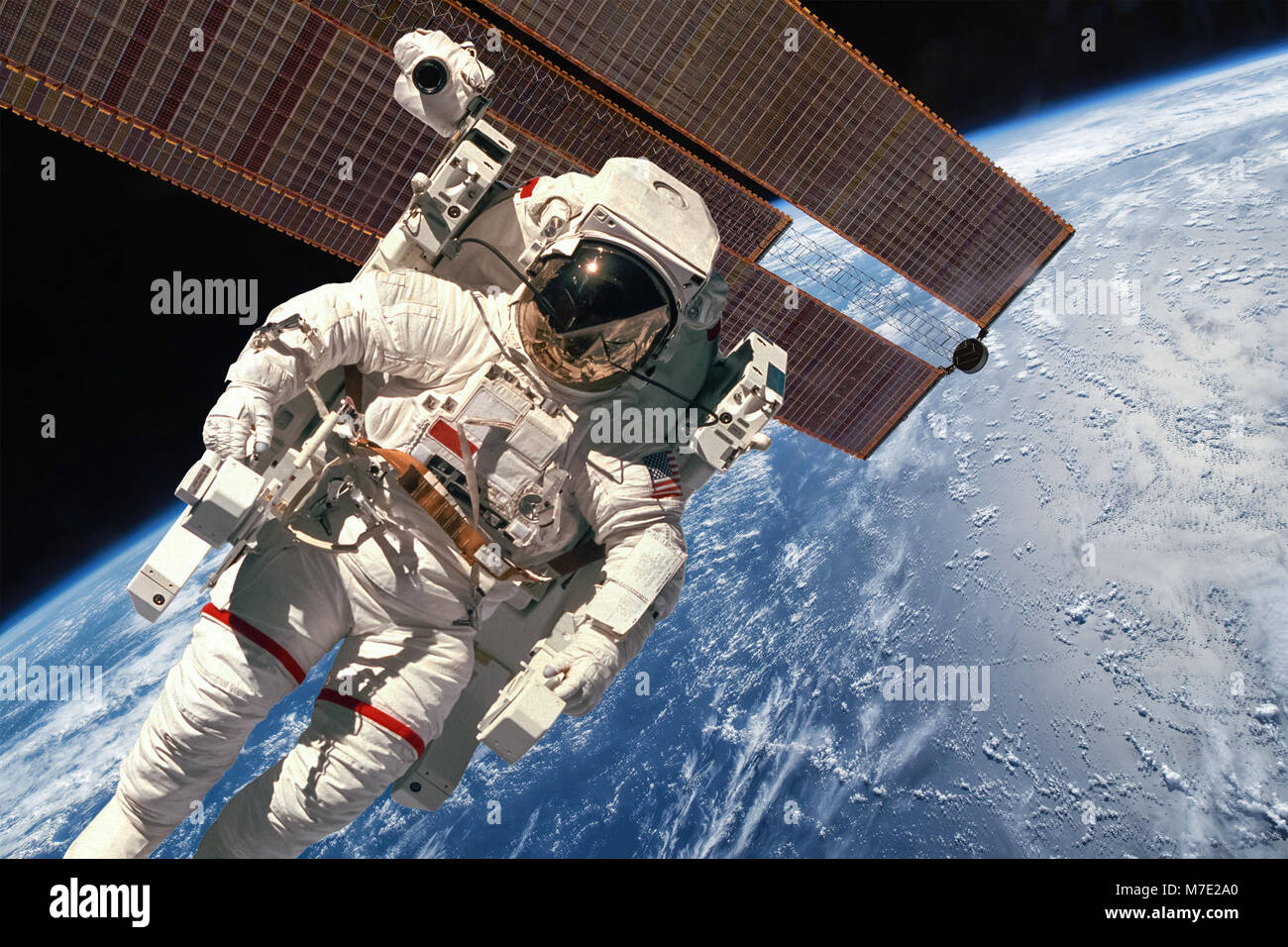 International Space Station and astronaut in outer space over the planet Earth. Elements of this image furnished - Stock Image