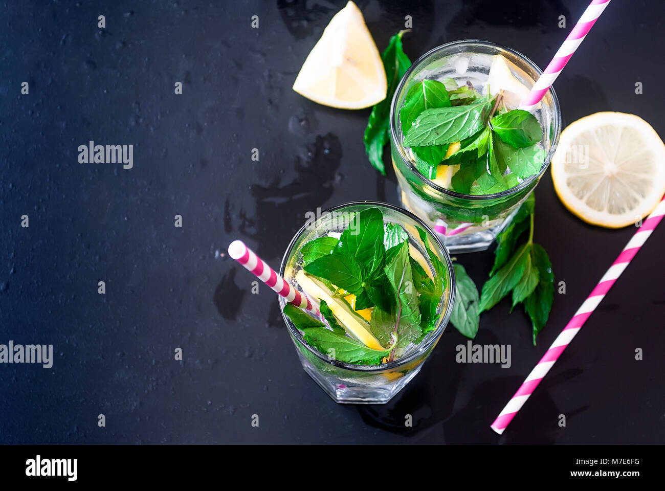 Fresh homemade lemonade in glass with ice and mint. - Stock Image