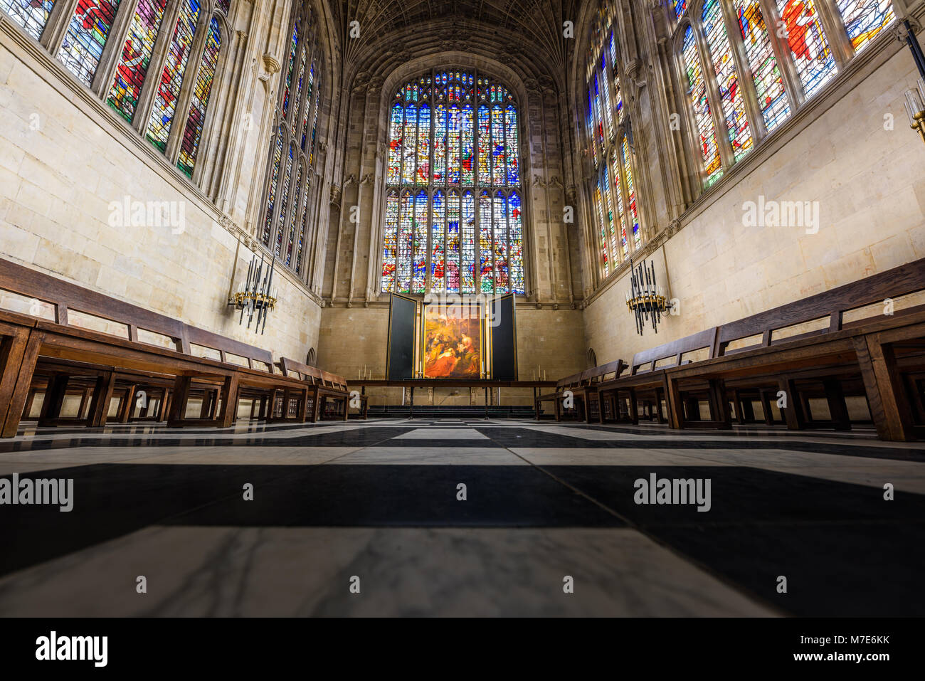 The choir with its floor, stained glass windows, altar, and painting by Rubens in the chapel at King's college, - Stock Image