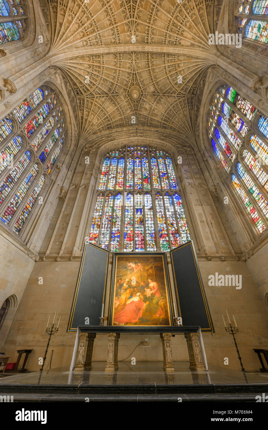 The choir with its floor, stained glass windows, fan ceiling, altar, and painting by Rubens in the chapel at King's - Stock Image