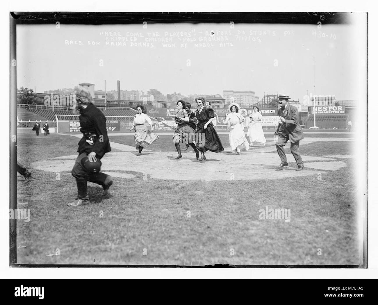 'Here come the players.' - Actors do stunts for crippled children, polo grounds race for prima donnas won - Stock Image