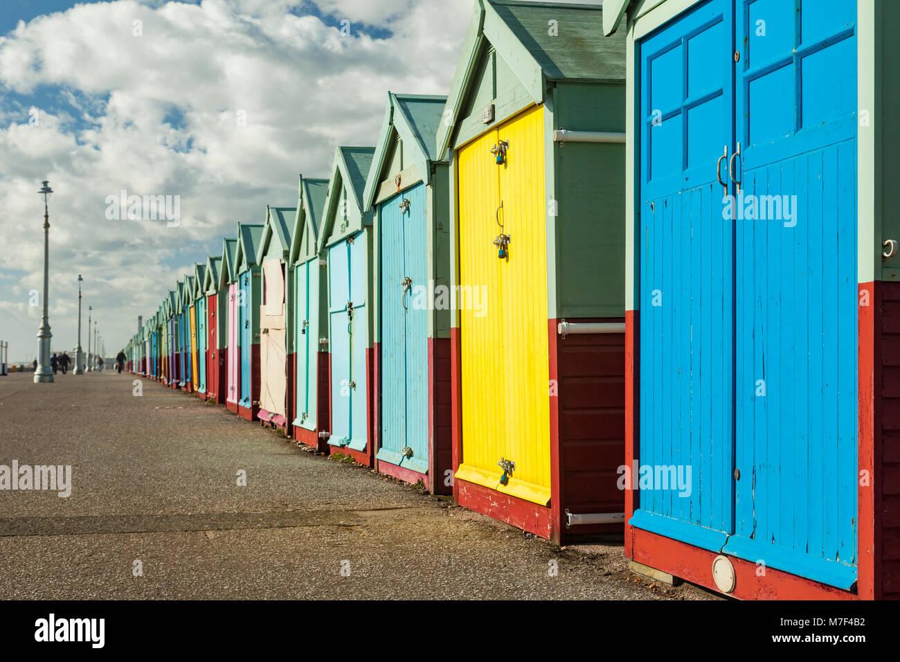 Multi-coloured beach huts on Hove seafront, UK. - Stock Image