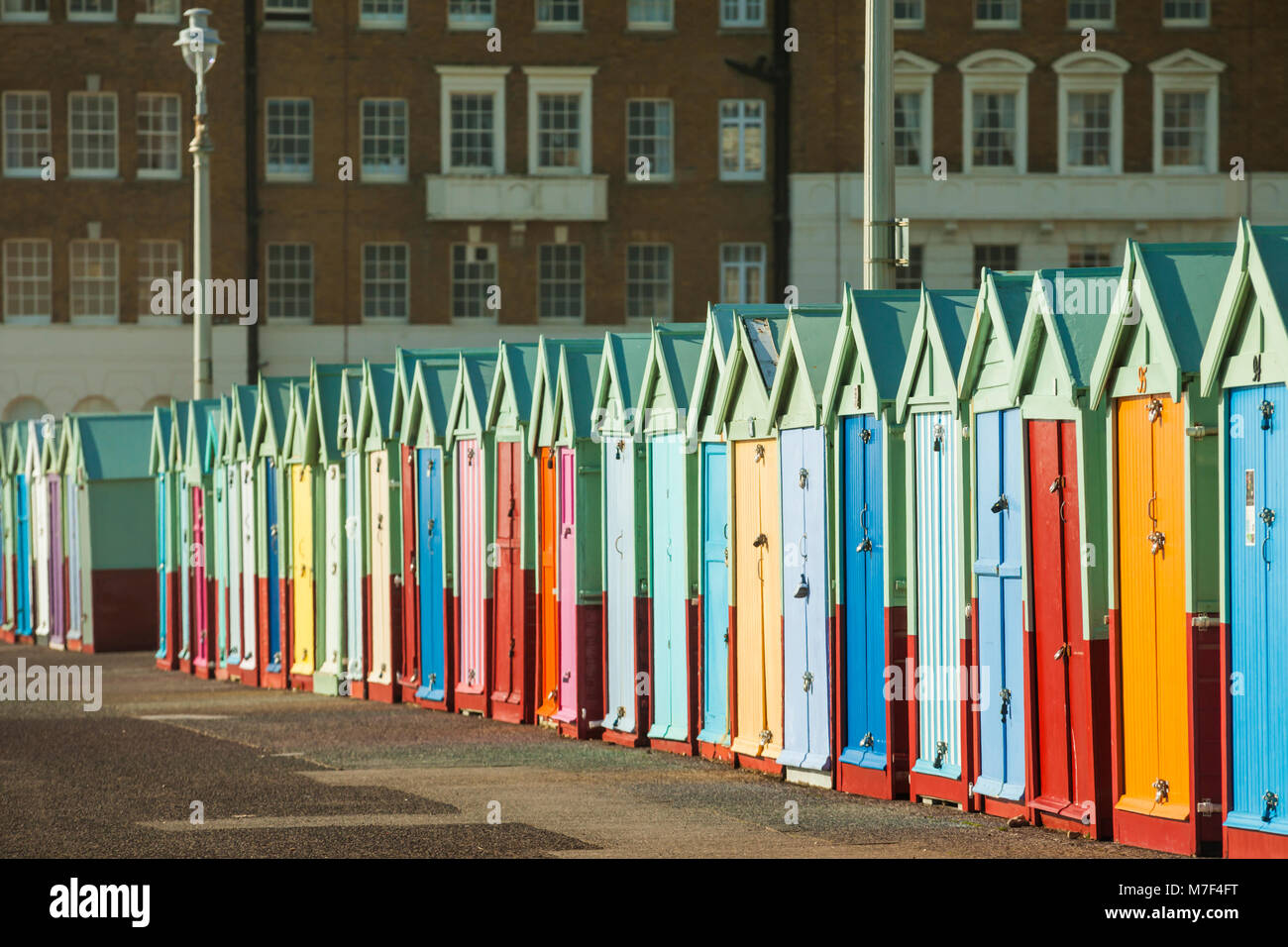 Beach huts on Brighton seafront, England. - Stock Image