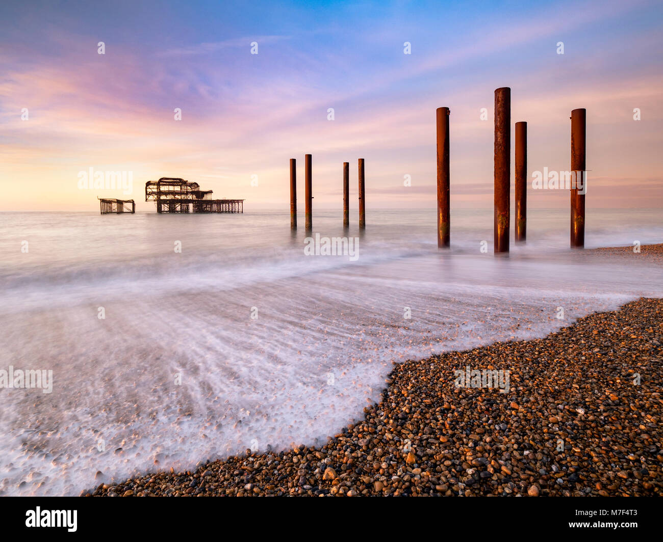 Winter sunrise at the old Pier, Brighton. Stock Photo