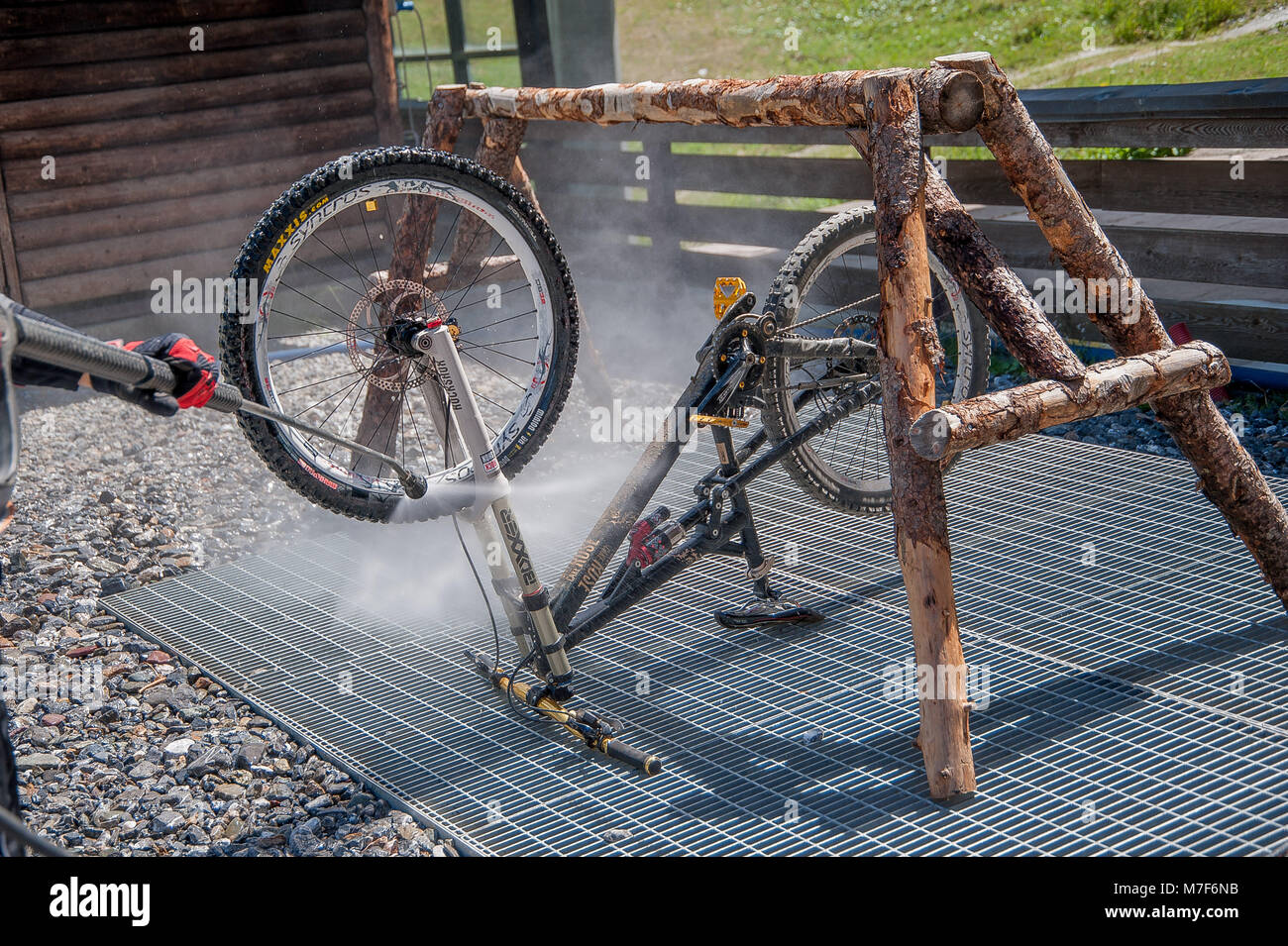 27 luglio 2015 Livigno italy : cleaning after bike ride through the ...