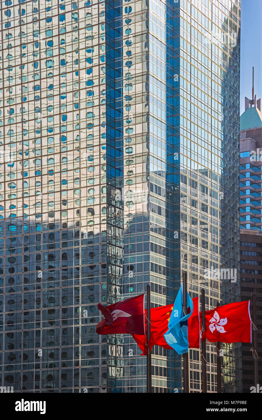 View from Exchange Square Plaza with High Rise and Flags, Hong Kong - Stock Image