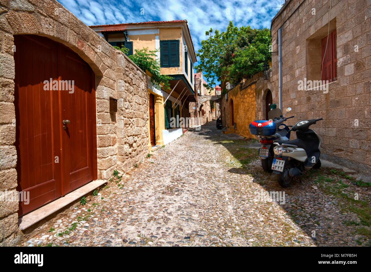 Narrow street and architecture of medieval Old Town of Rhodes, Greece - Stock Image