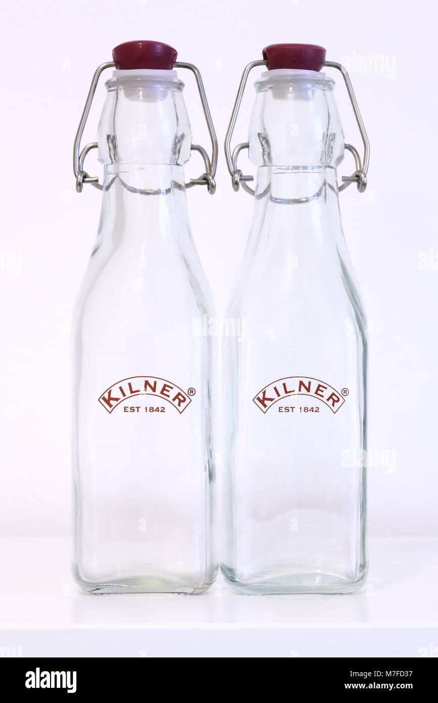 Kilner glass clip-top preserving bottles with Kilner logo - Stock Image