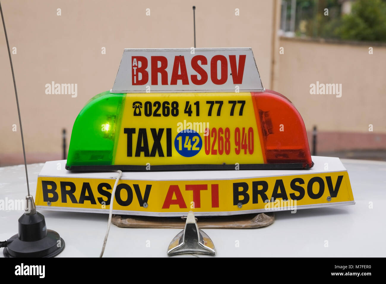 Close-up of a taxi dome sign in the town of Brasov, Romania, Eastern Europe. - Stock Image