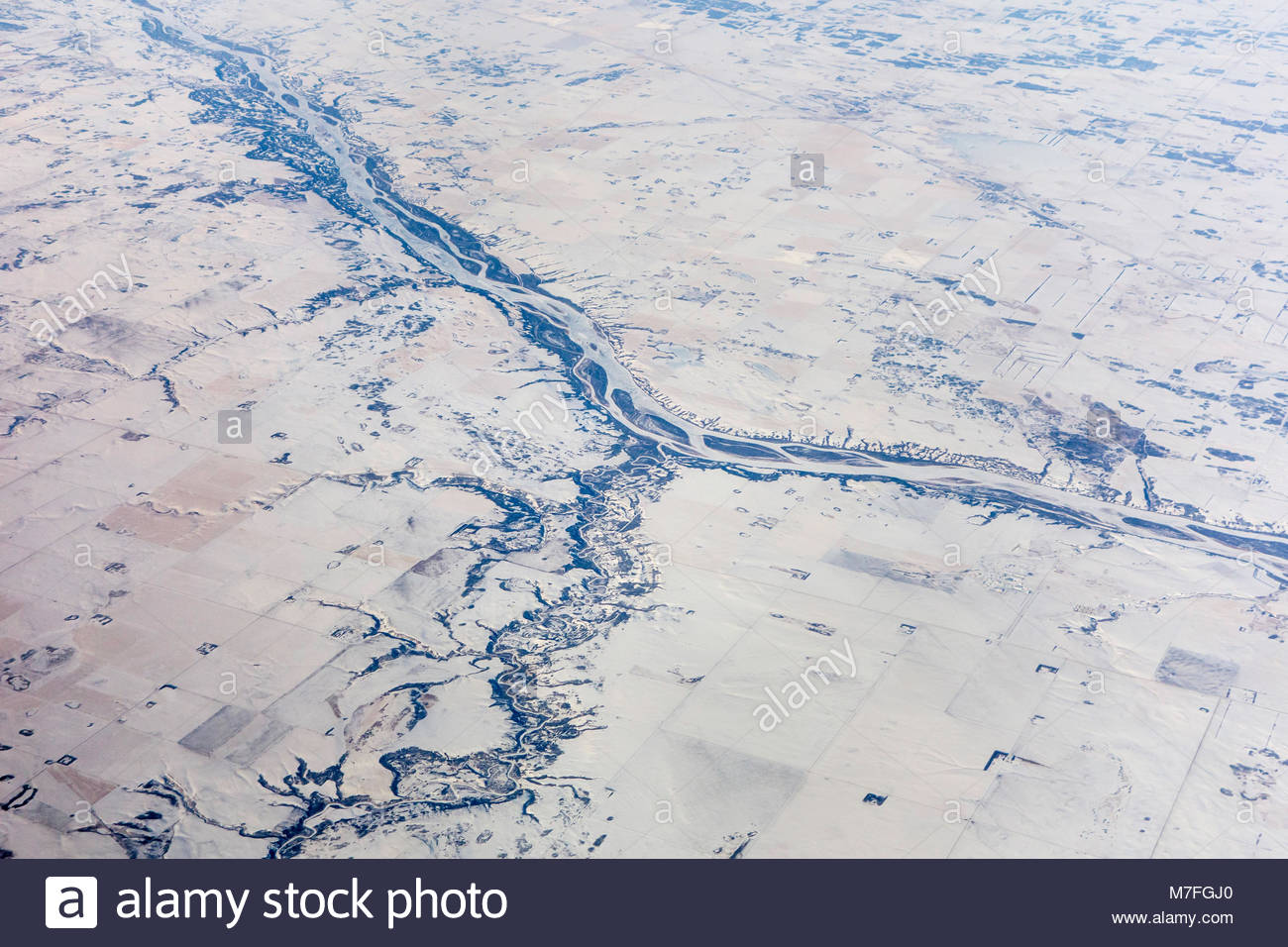 Eagle Creek (bottom) joining the North Saskatchewan River (top) on the prairie near Saskatoon Saskatchewan Canada. - Stock Image