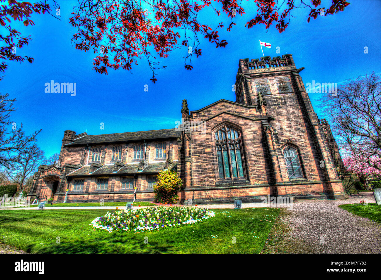 Village of Port Sunlight, England. Artistic spring view of Port Sunlight's Christ Church. - Stock Image