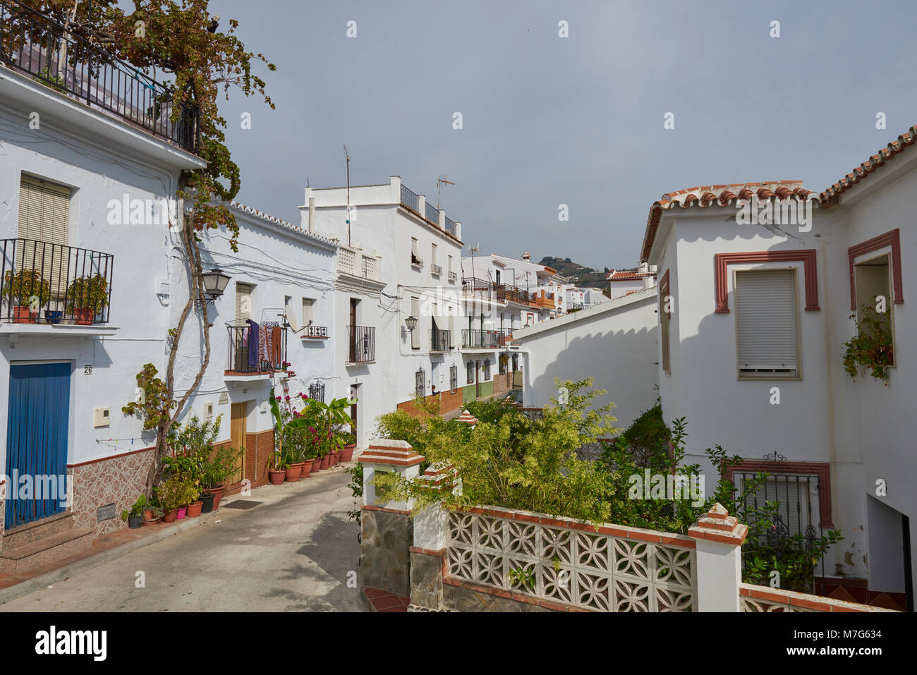 The Streets of Sayalonga remain deserted during the Spanish siesta period on a hot Summer afternoon. - Stock Image