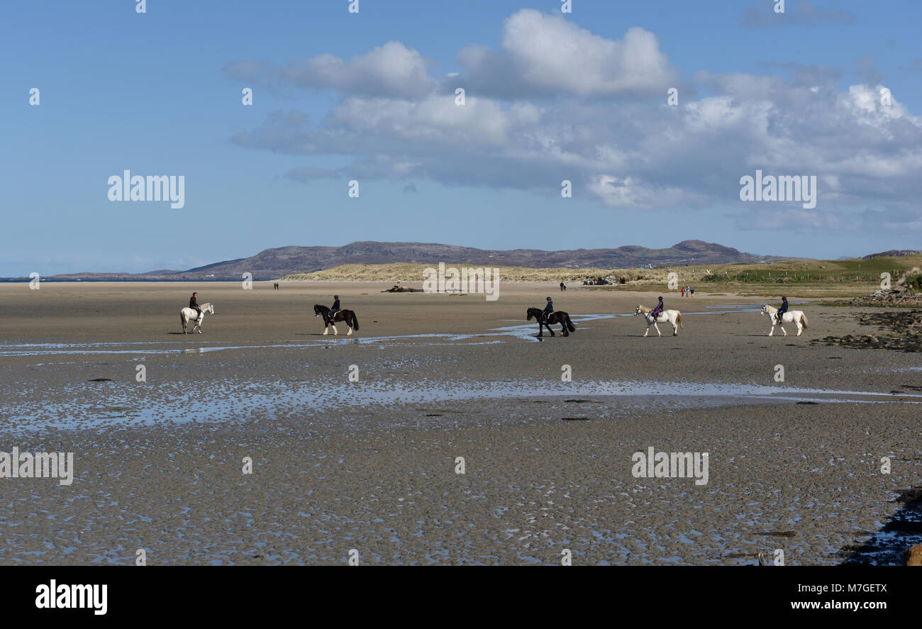 Horse riding Dunfanaghy Beach County Donegal Ireland - Stock Image