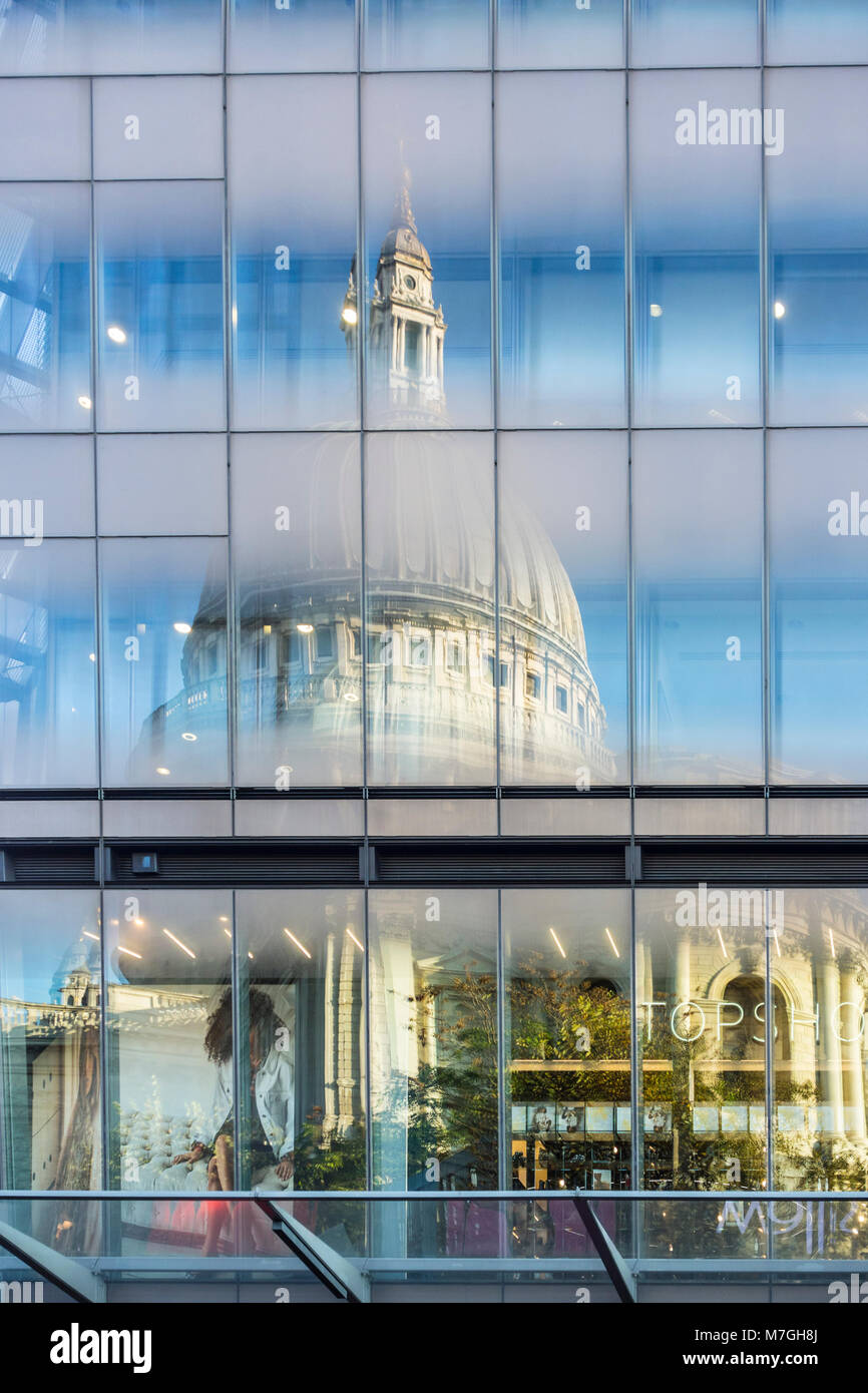 St Paul's Cathedral reflected in windows of One New Change shopping centre, City of London, UK - Stock Image