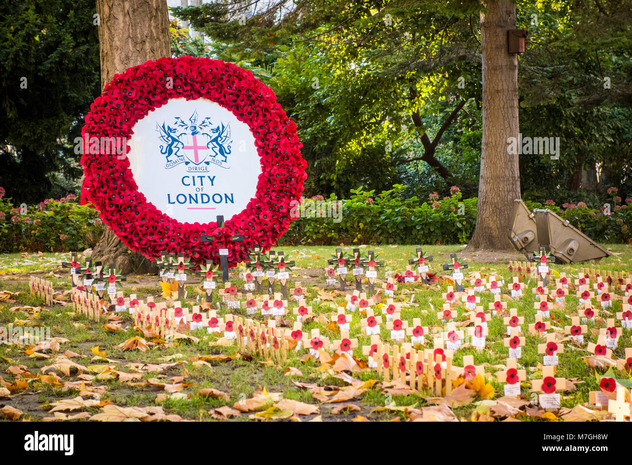 Remembrance day poppies and wreath in St Paul's Churchyard, City of London, UK - Stock Image
