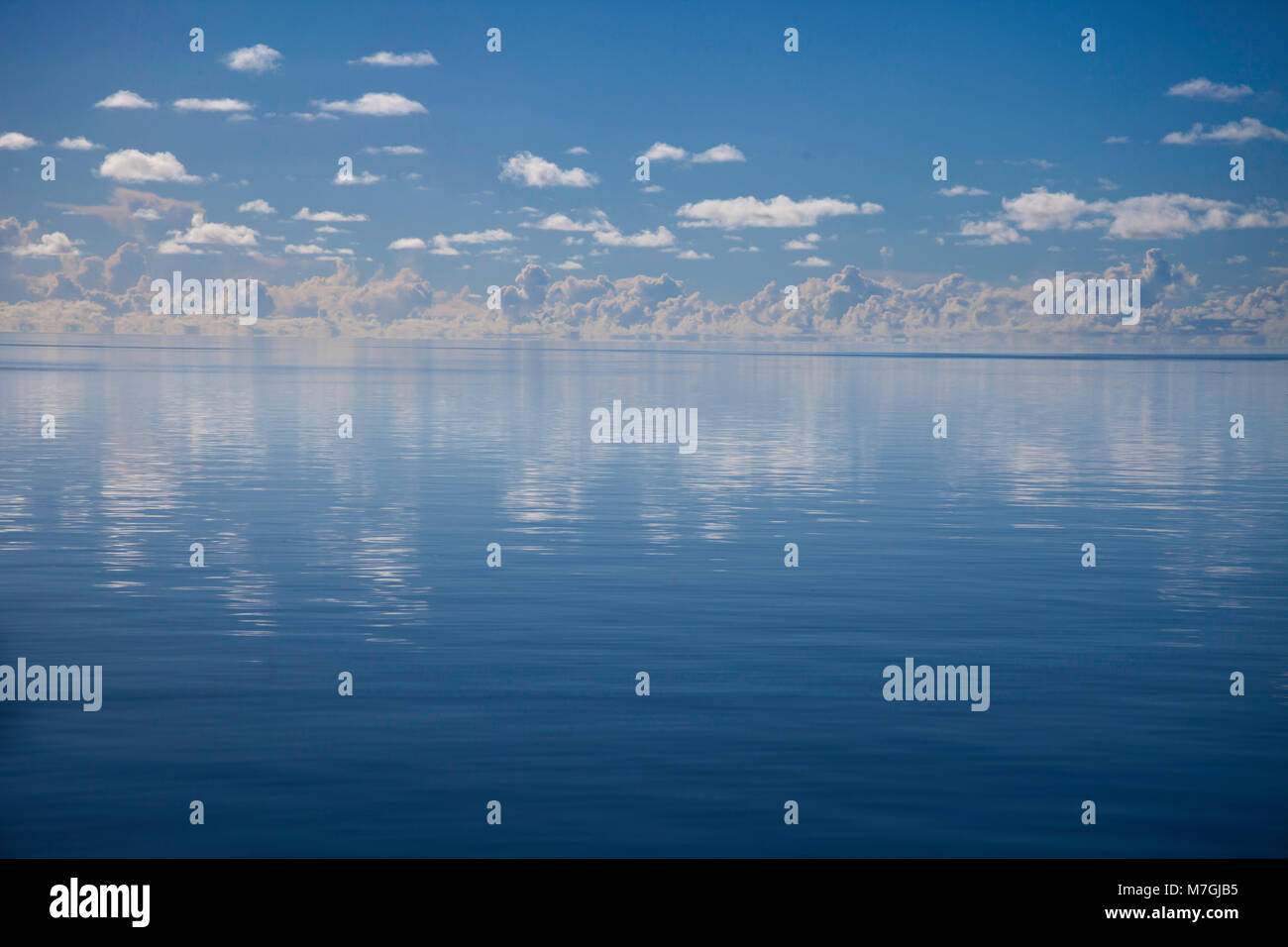 A glassy flat day on the ocean off the island of Yap, Micronesia. - Stock Image
