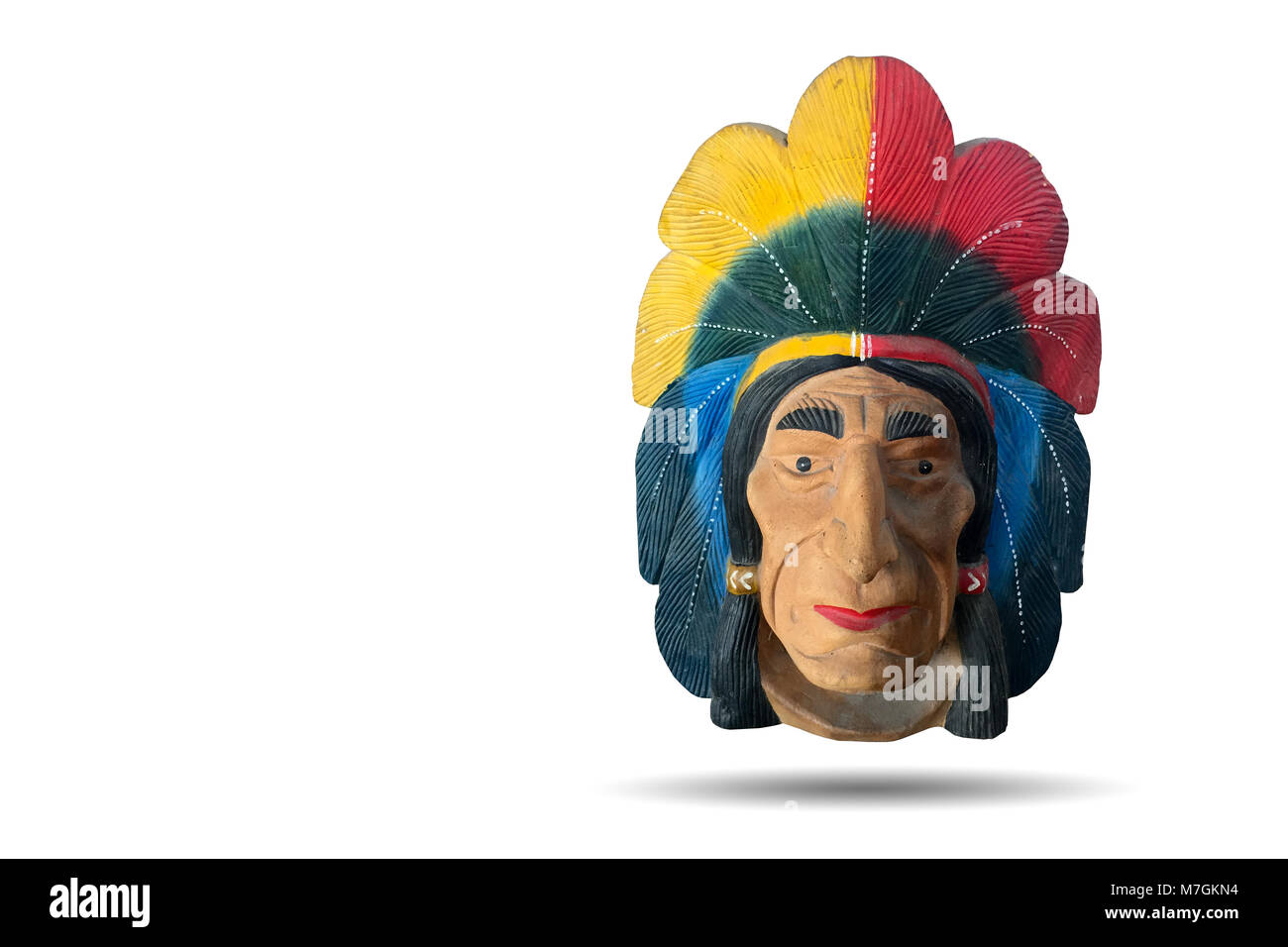 Plaster sculpture of red indian, native american people. Showing the tribe chief face and headdress full of eagle - Stock Image