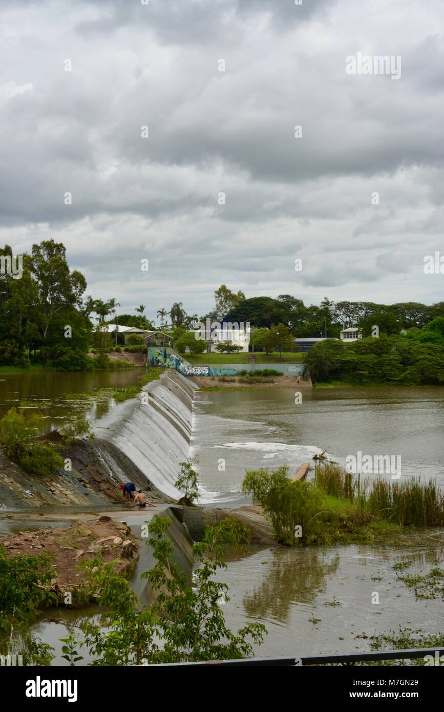 The weir near Riverview Tavern in Douglas with water flowing over the top, Townsville Queensland Australia - Stock Image
