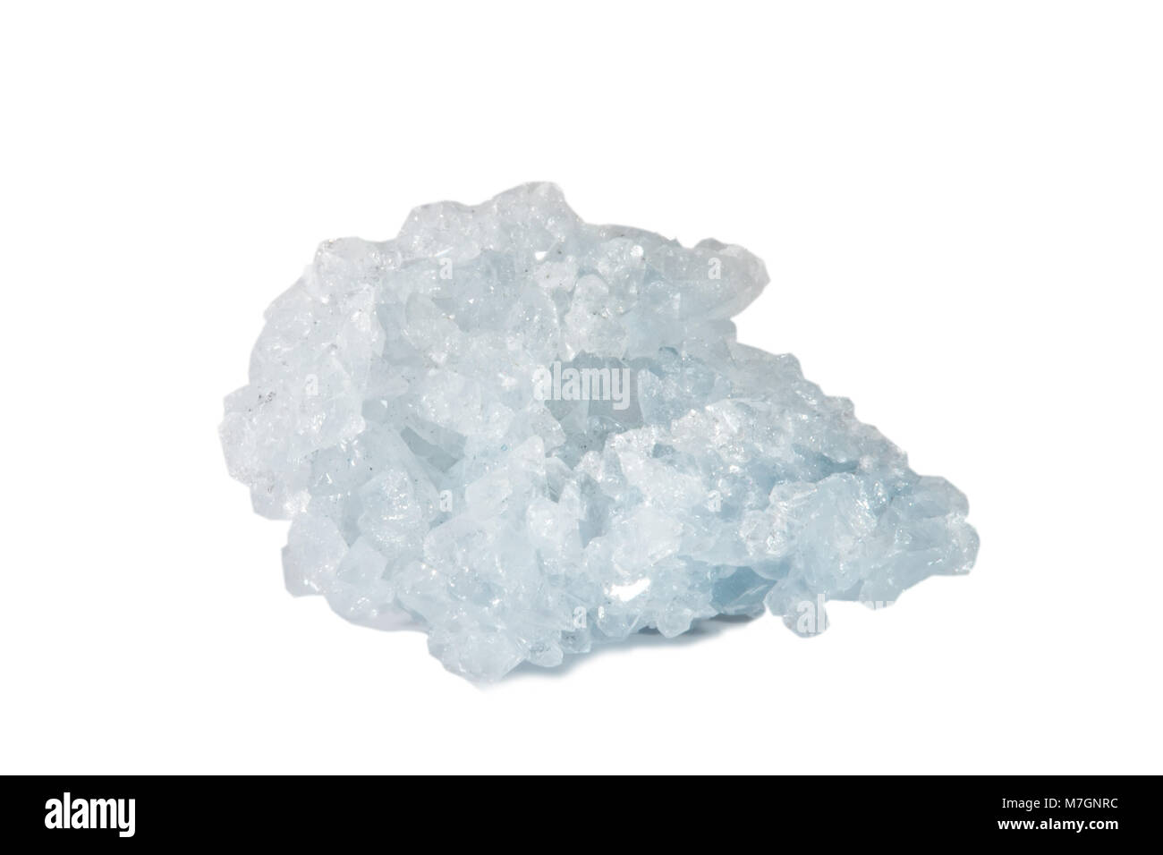 Macro shooting of natural gemstone. The raw mineral is Celestine, Madagascar. Isolated object on a white background. - Stock Image