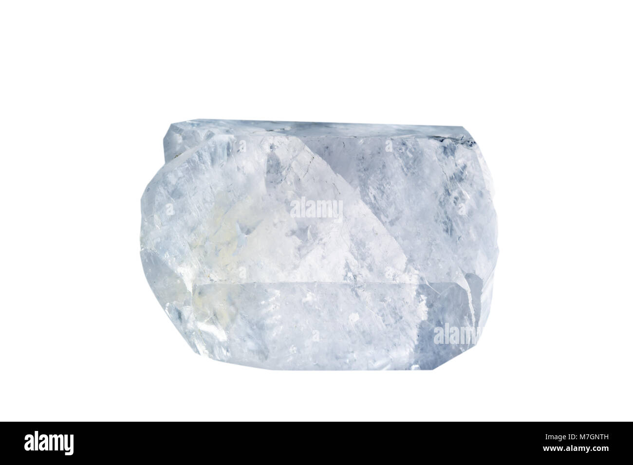 Macro shooting of natural gemstone. The raw mineral is calcite. Isolated object on a white background. - Stock Image