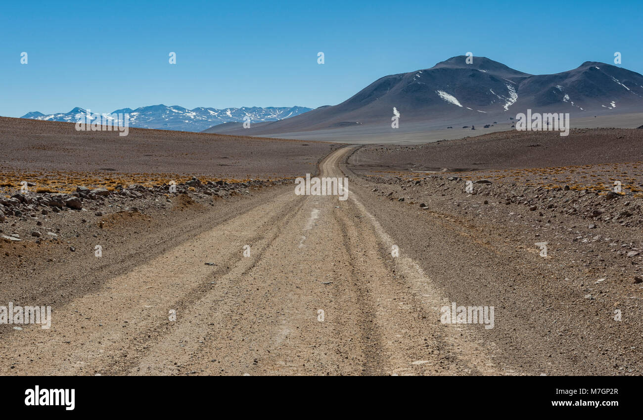 Unpaved road in the beautiful landscape of Bolivia, South America - Stock Image