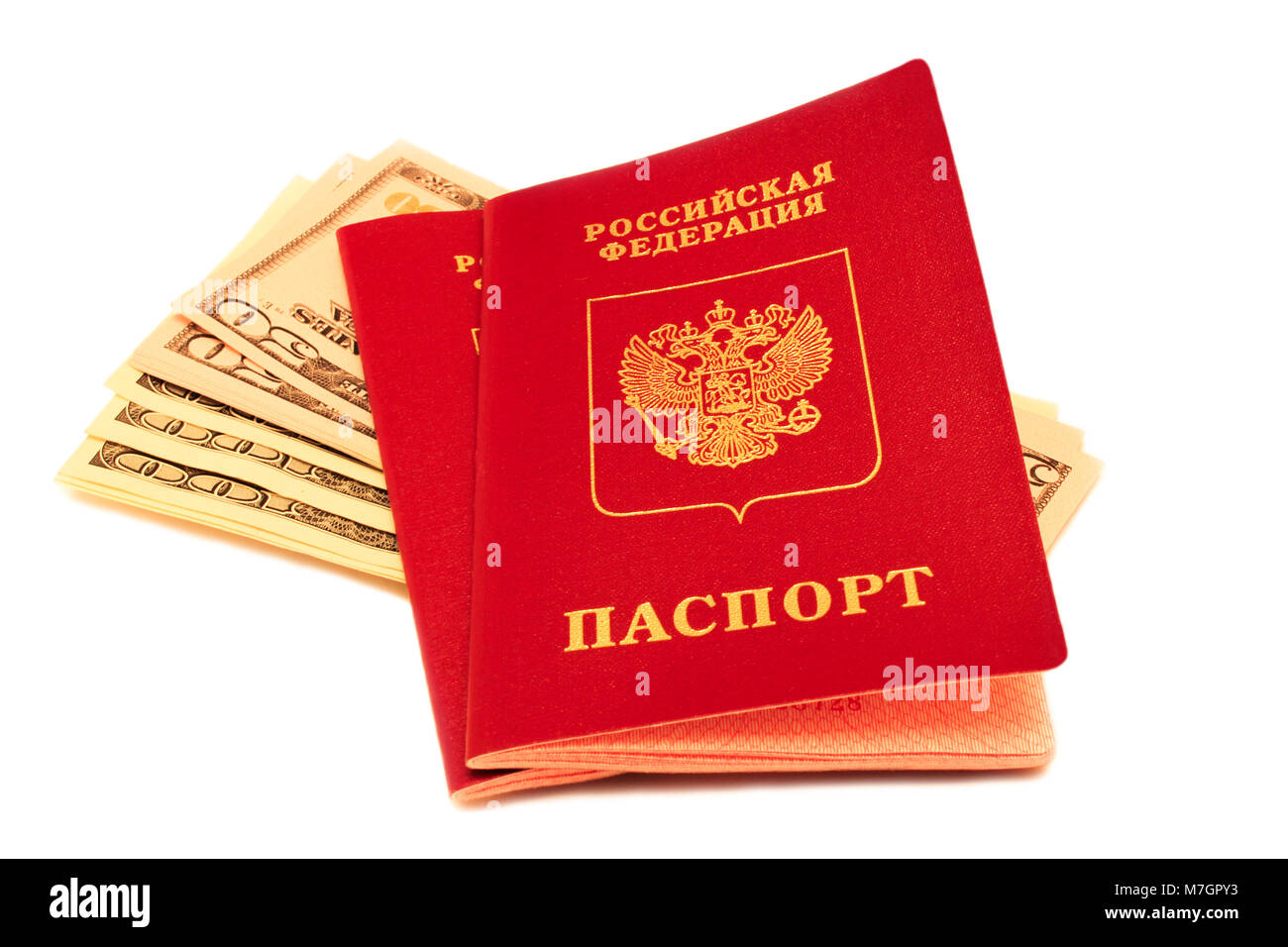 Russian passports are on american currency isolated on white background. - Stock Image