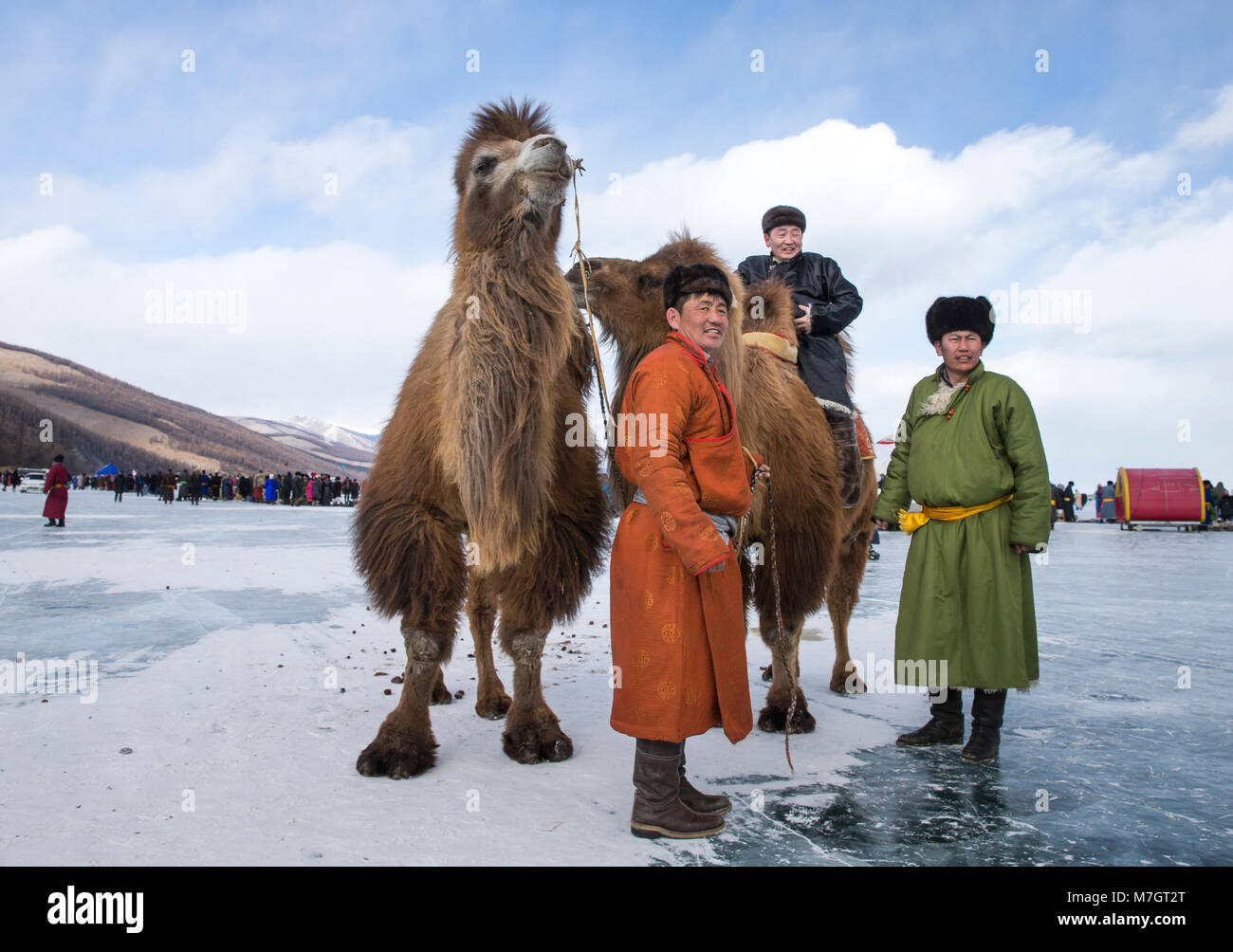 Hatgal, Mongolia, 3rd March 2018: mongolian people on a frozen lake Khuvsgul during a ice festival in winter - Stock Image
