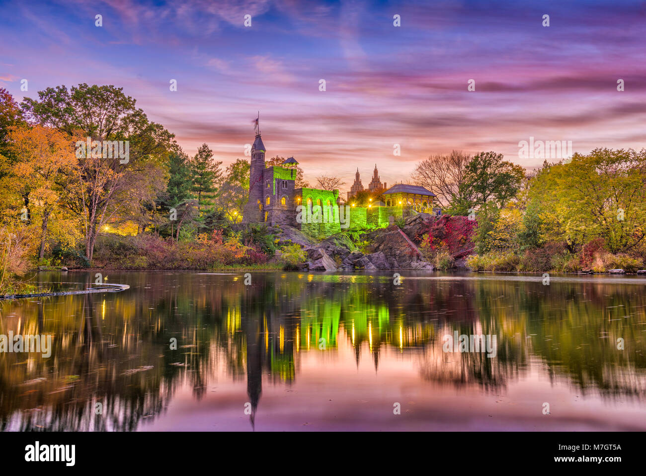 New York, New York at Central Park's castle and pond during an autumn dusk. - Stock Image