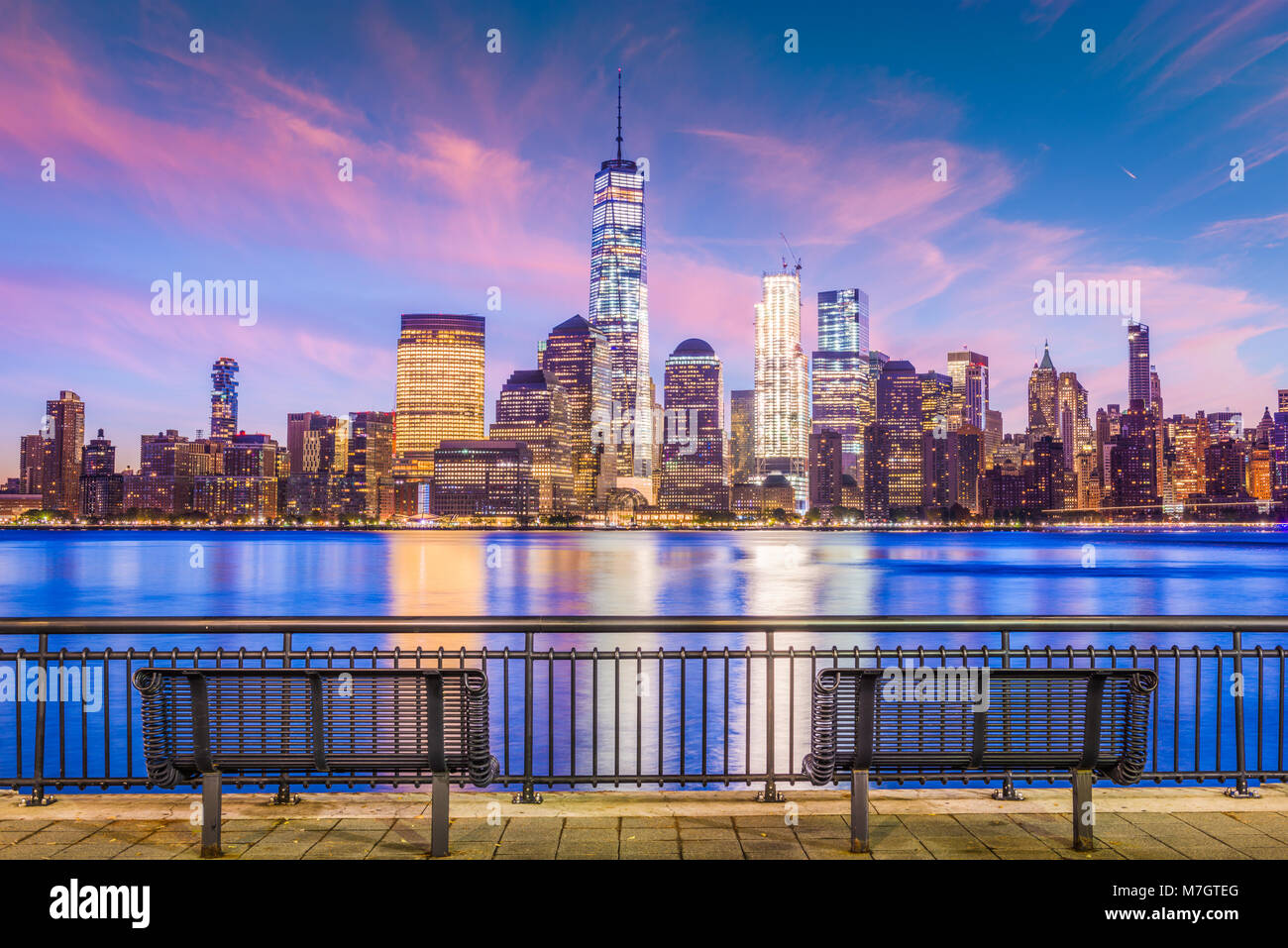 New York City financial district on the Hudson River at twilight. - Stock Image