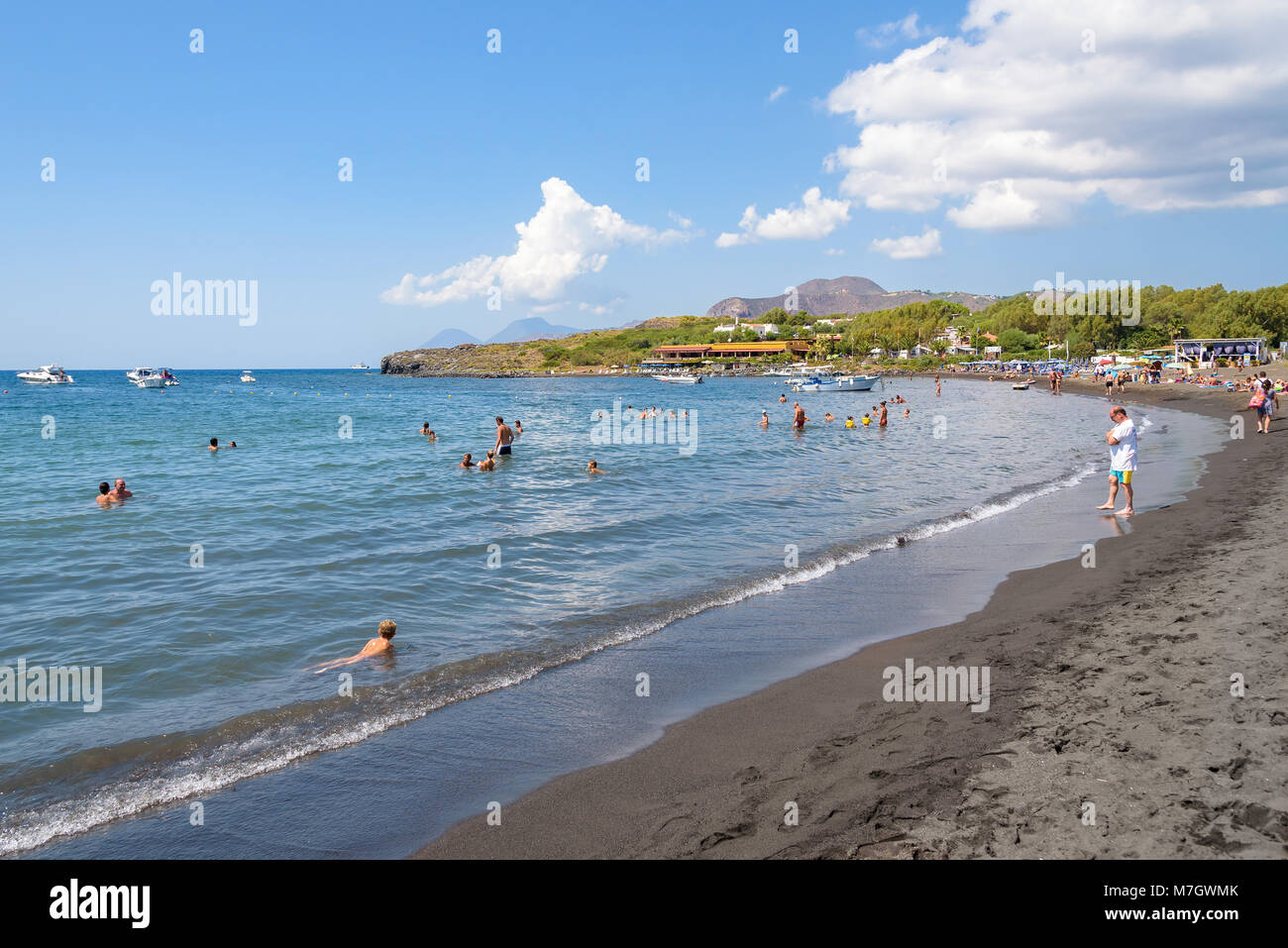 Vulcano Island, Italy - August 22, 2017: People relax on the black volcanic beach on Vulcano Island. Stock Photo