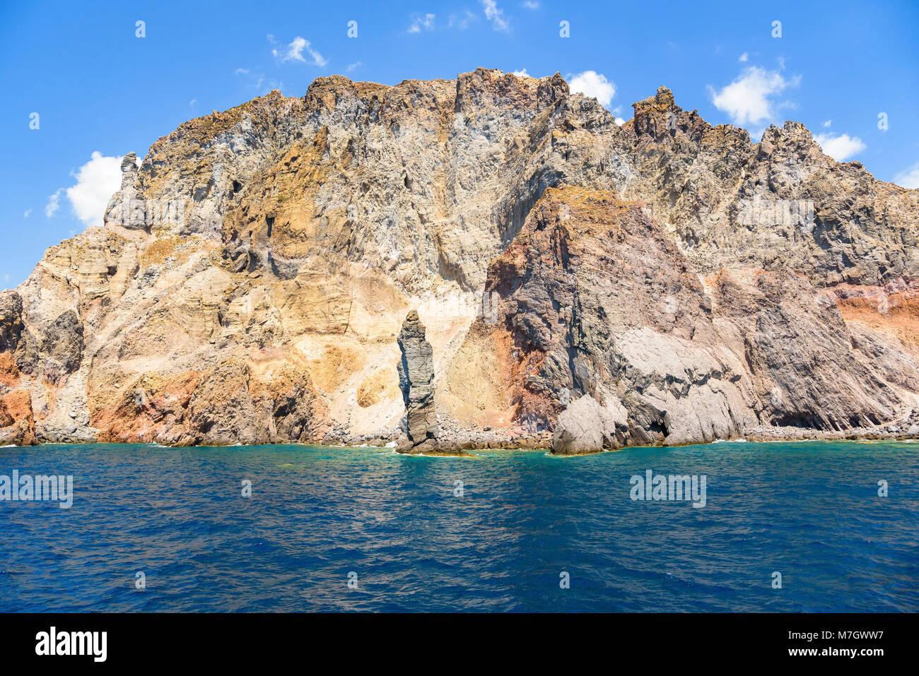 Rocky cliff coast of the Lipari Island seen from the sea, Aeolian Islands, Italy Stock Photo