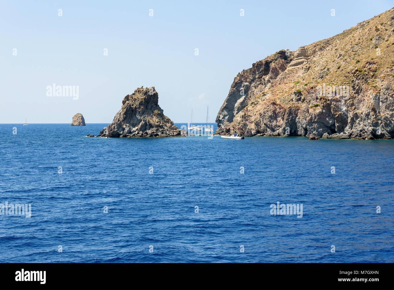 Yachts at the rocky coast of Lipari Island, Aeolian Islands, Italy Stock Photo