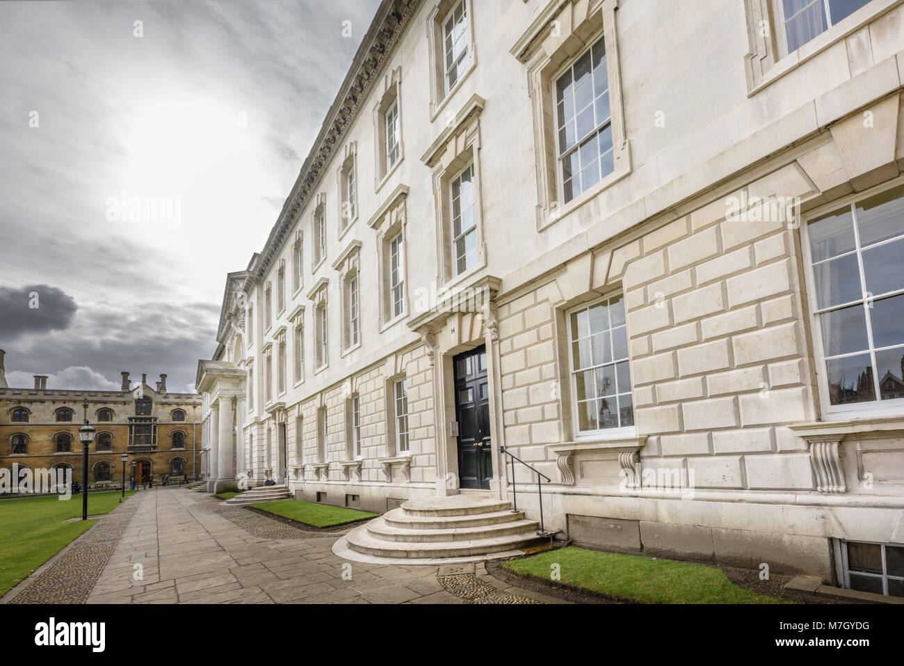 The facade of the Gibb's building, made of portland stone, at King's college, university of Cambridge, England. - Stock Image