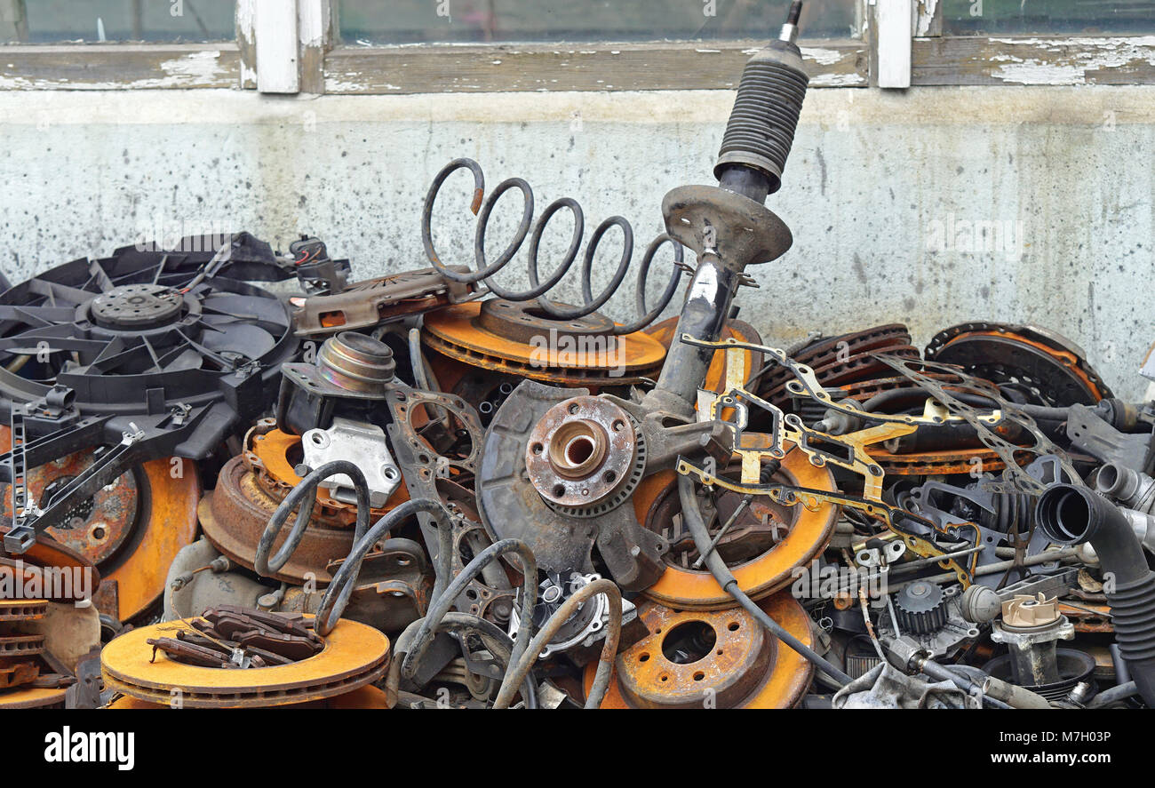 Pile of old car parts scrap metal for recycling Stock Photo ...