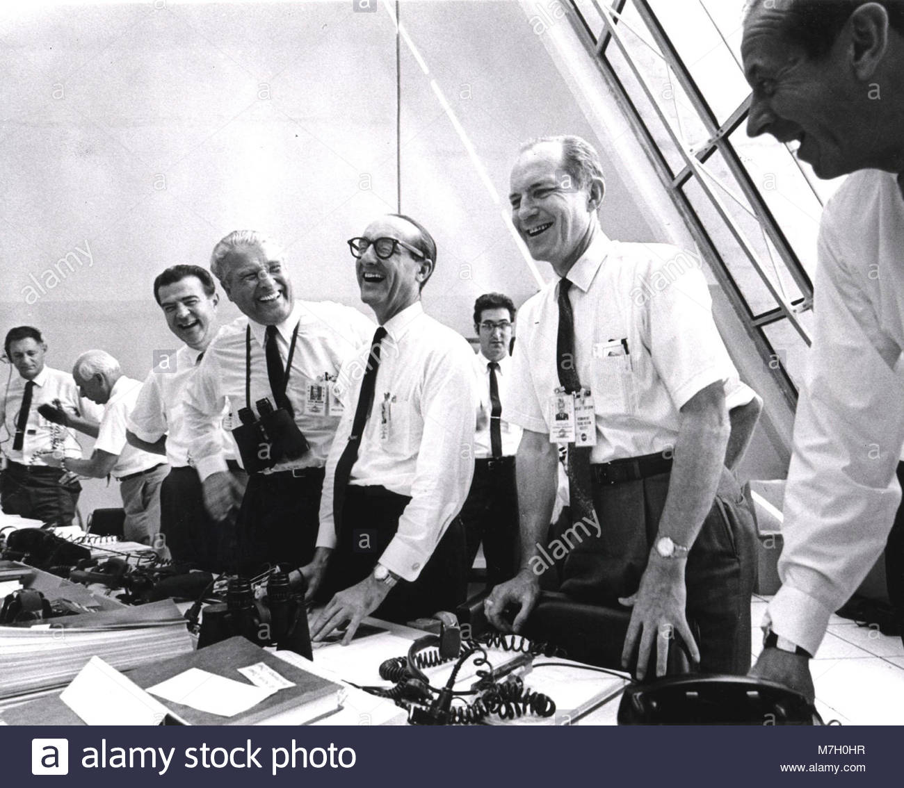 Moon Bound - Apollo 11. Apollo 11 mission officials relax in the Launch Control Center following the successful - Stock Image