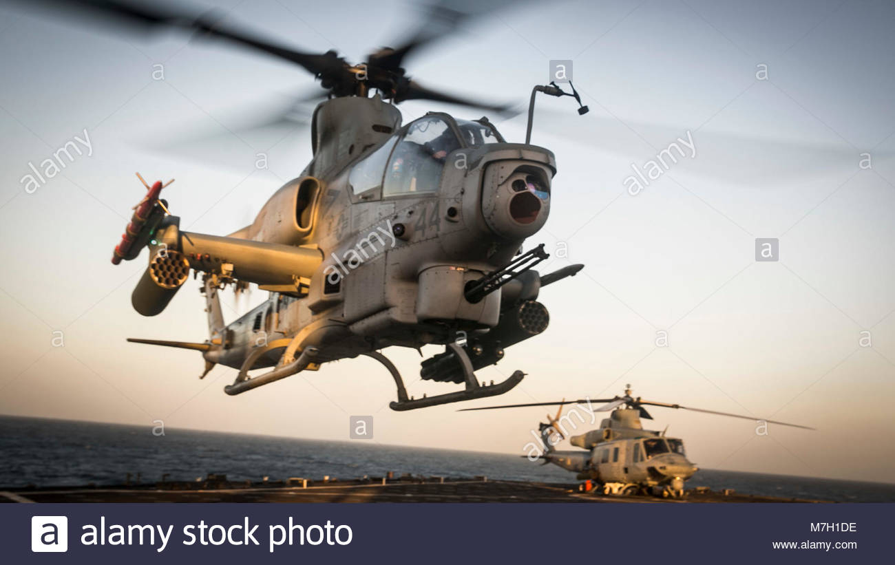 Bell AH-1Z Viper. OCEAN (May 12, 2017) An AH-1Z Viper attack helicopter takes off from the flight deck aboard the Stock Photo