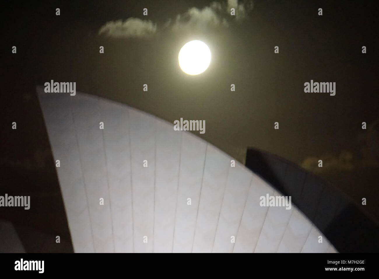 Moon rising over Sydney Opera House - Stock Image