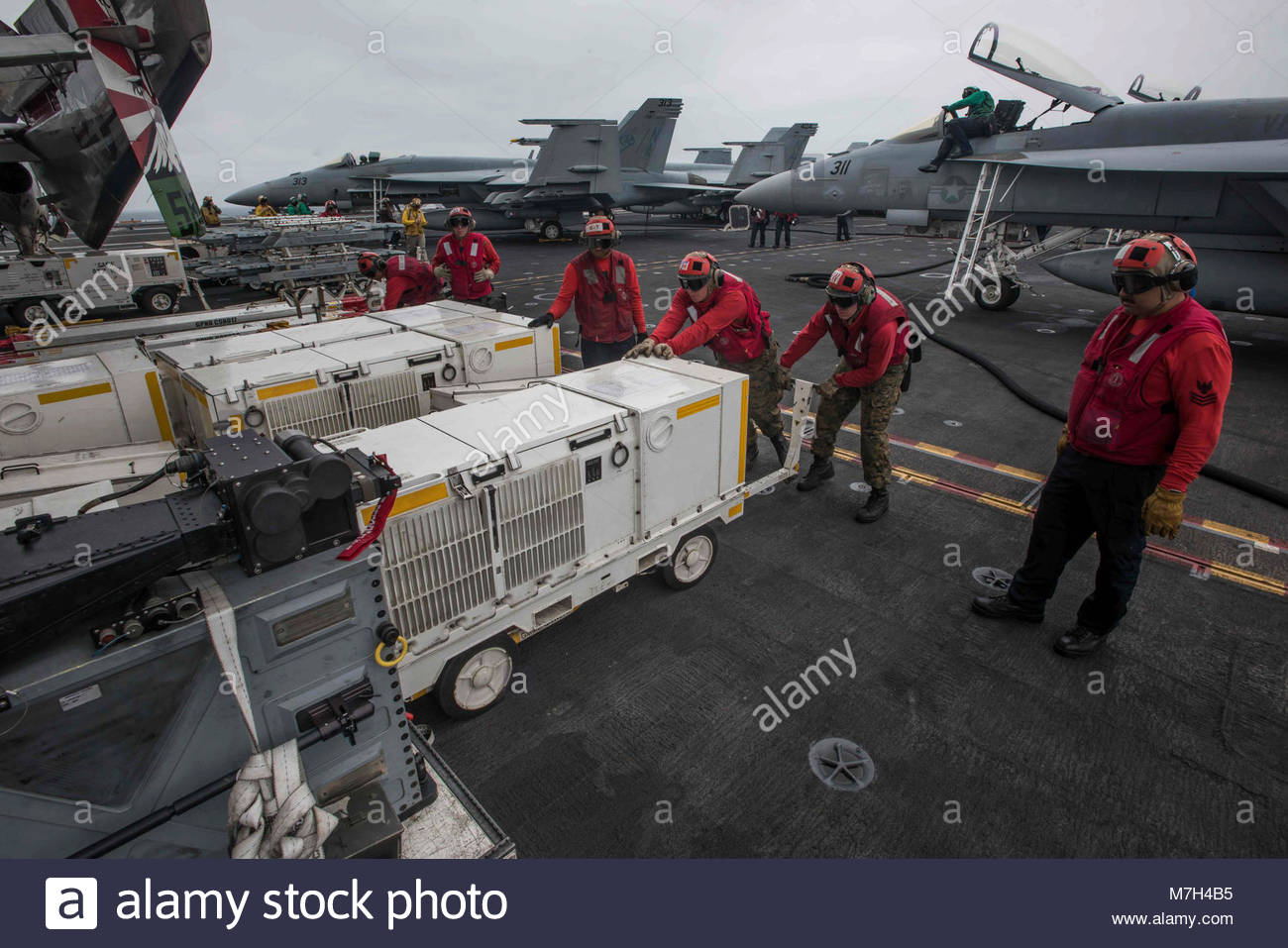 USS Theodore Roosevelt (CVN 71). PACIFIC OCEAN (Aug. 8, 2017) Sailors and Marines secure ordnance on the flight Stock Photo